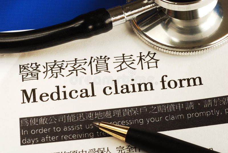 Complete the medical claim form. Concept of medical insurance stock image