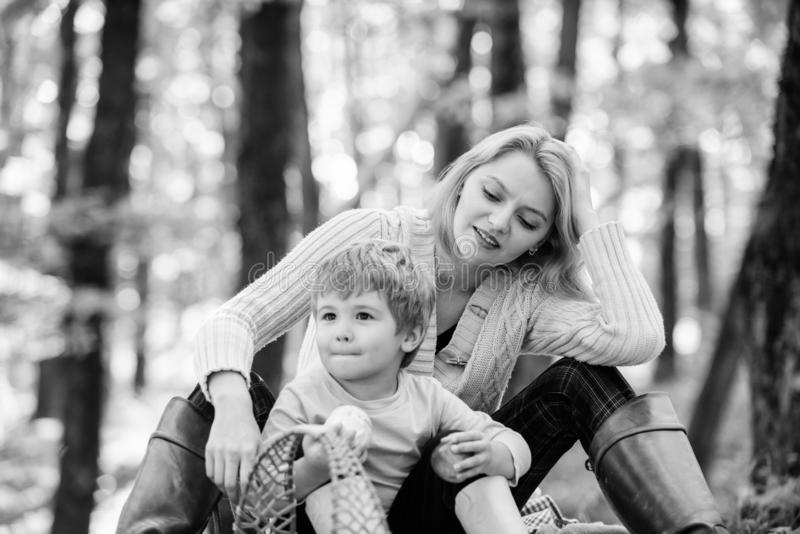 Complete relax. Happy son with mother relax in autumn forest. Family picnic. Mothers day. Mother love her small boy stock photos