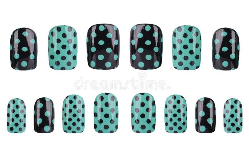 Complete set of black and green fake nails painted with dots, isolated on white background, clipping path included royalty free stock photo