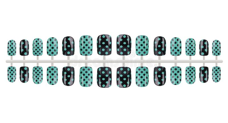 Complete set of black and green fake nails painted with dots, isolated on white background, clipping path included royalty free stock images