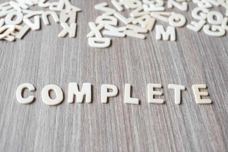 COMPLETE word of wooden alphabet letters. Business and Idea. Concept royalty free stock photo