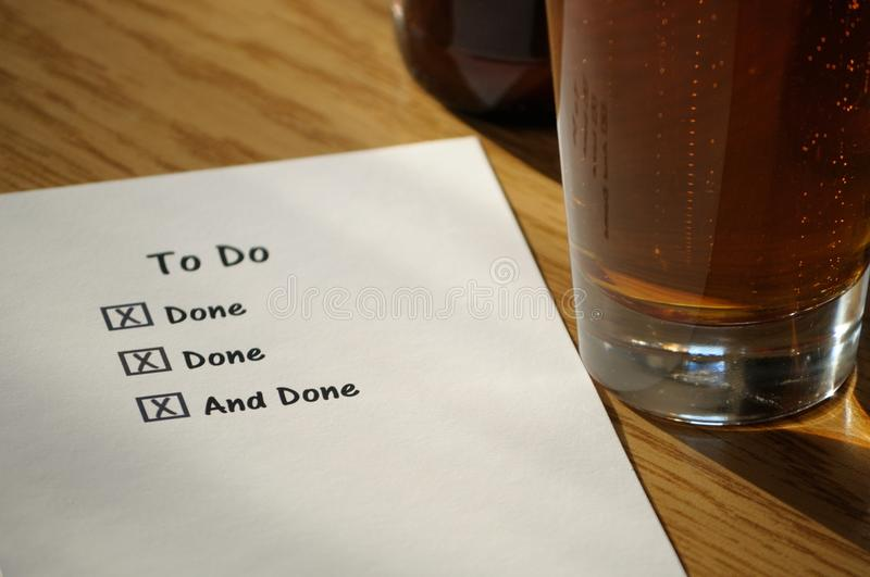 Completed To Do List with Beer Glass stock image