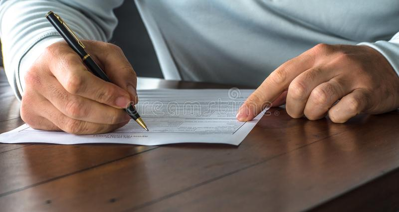 Completing a medical form at home royalty free stock photography