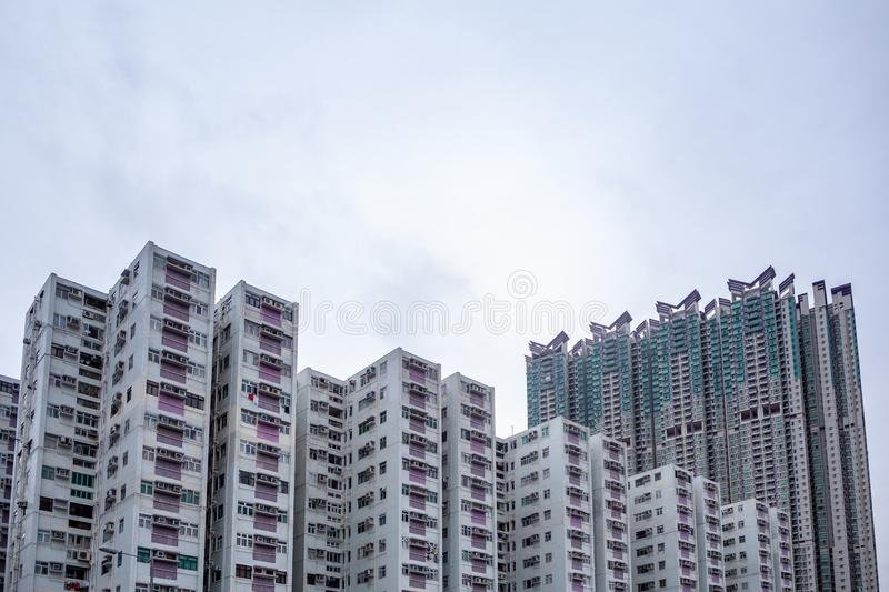 Complex of condominium buildings in residential district with overcast sky background stock photography