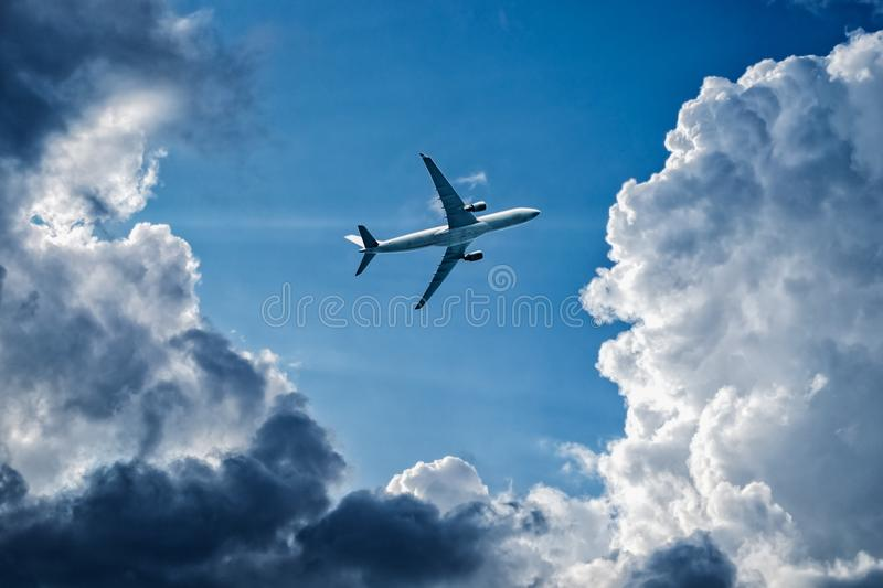 Complex flight conditions - plane flies through storm clouds, rainy weather, storm front. Concept of air safety. Empty place for copy space stock photos