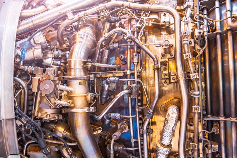 The complex mechanism of tubes and other binder systems in an airplane jet engine, close-up view. Industrial Production Theme stock photos
