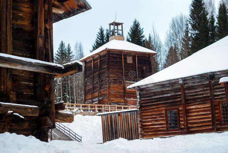 Antique wooden industrial architecture. Complex of traditional wooden buildings of a salt-mining plant of the 19th century in a winter landscape stock photo
