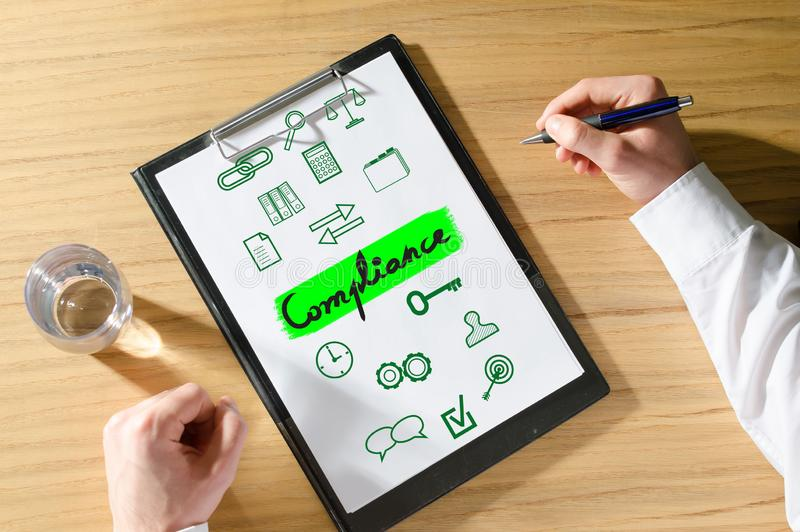 Compliance concept on a desk stock illustration