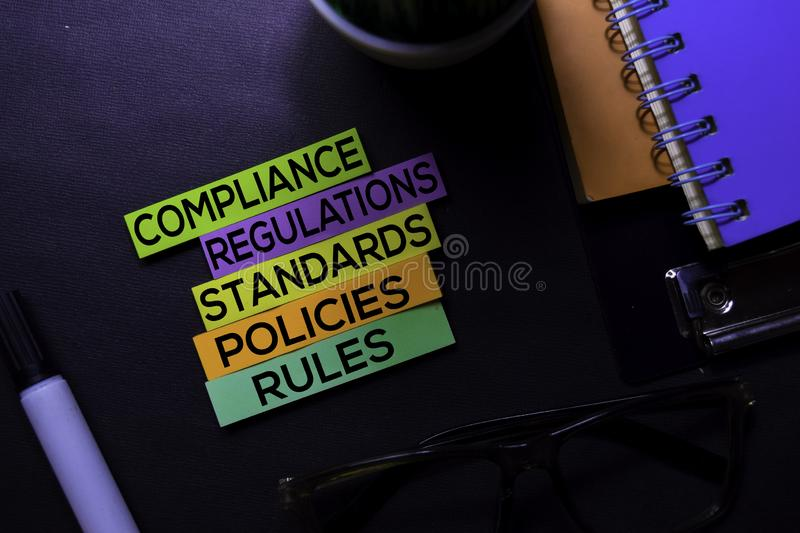 Compliance, Regulations, Strandards, Policies, Rules text on sticky notes isolated on Black desk. Mechanism Strategy Concept royalty free stock photos