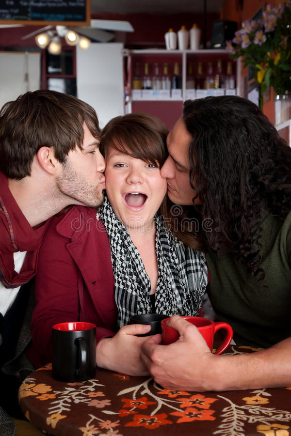 A complicated love triangle. At a coffee house stock images