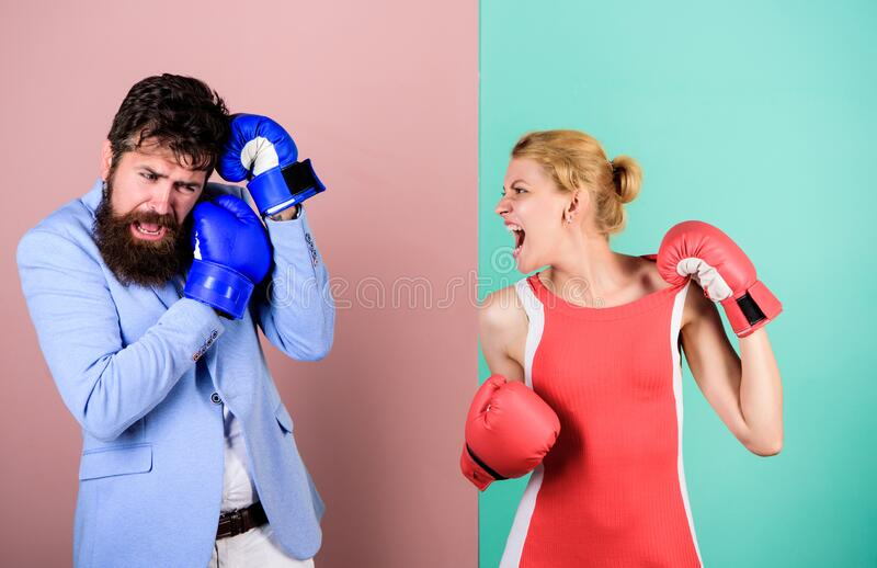 Complicated relationships. Couple romantic relationships. Man and woman boxing fight. Boxers fighting gloves. Difficult. Complicated relationships. Couple stock image