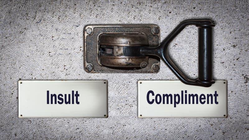 Compliment de commutateur de mur contre l'insulte photographie stock libre de droits