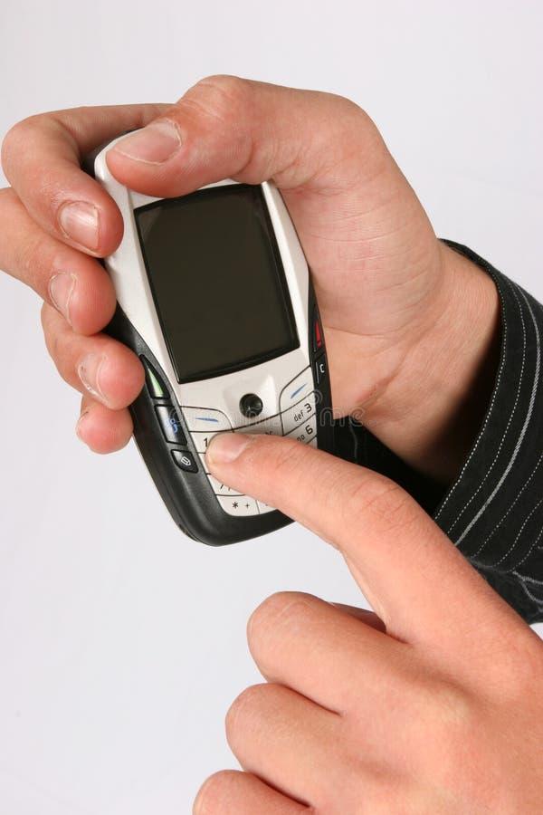 Componendo su un telefono cellulare immagini stock
