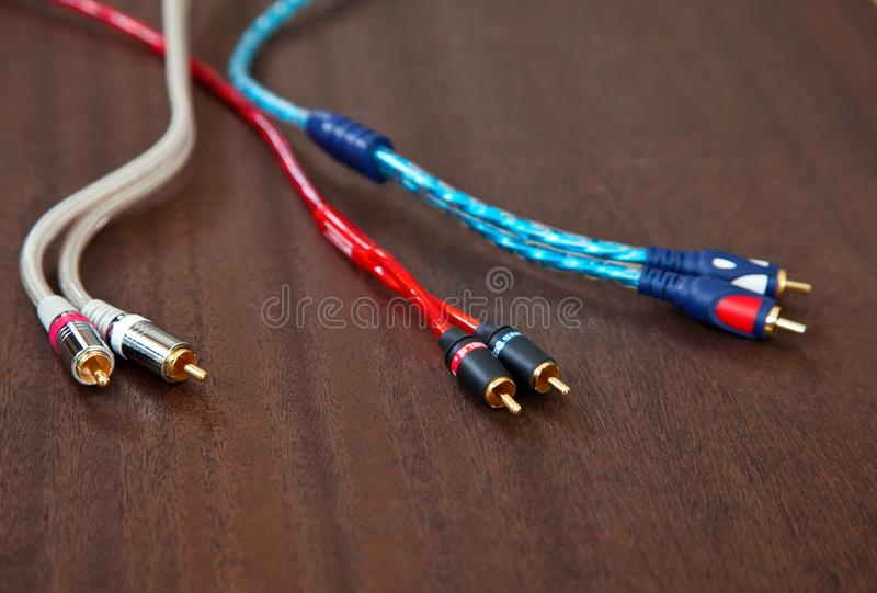 Toronto, Canada - August 12, 2019: Component Inter Connect Audio Wire Cable with RCA Male Plug on Wooden Desk royalty free stock photo