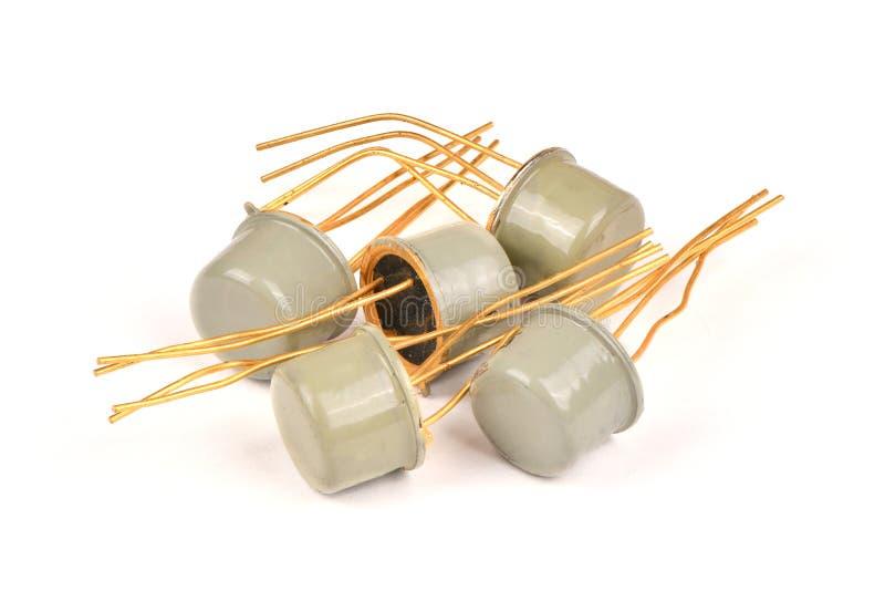 Componente de rádio velho, o transistor do semicondutor com os contatos cobertos com o ouro fotografia de stock