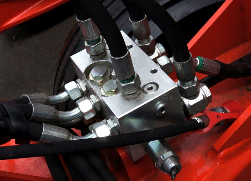 Componentes hidráulicos da maquinaria foto de stock