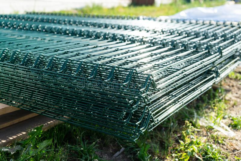 Components for the construction of a mesh fence. Components for the construction of a mesh fence royalty free stock photos