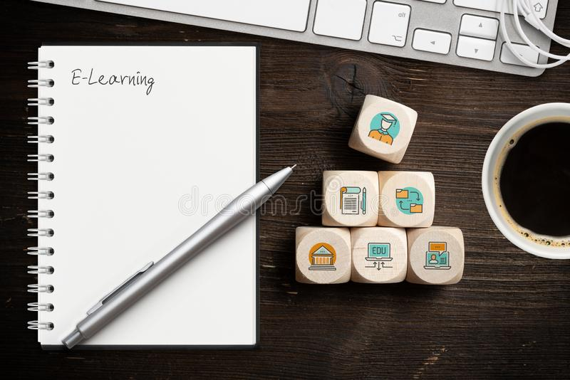 Components of digital learning as icons on cubes and the word `e-learning ` royalty free stock images