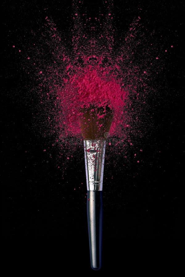 Componga le spazzole con l'esplosione della polvere fotografia stock libera da diritti