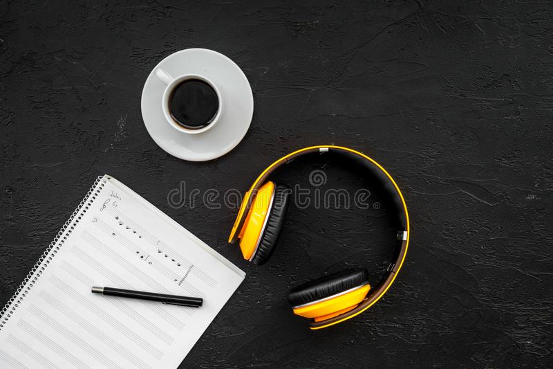 Composer and song writer desktop with headphones and notes on black background top view mock up stock images