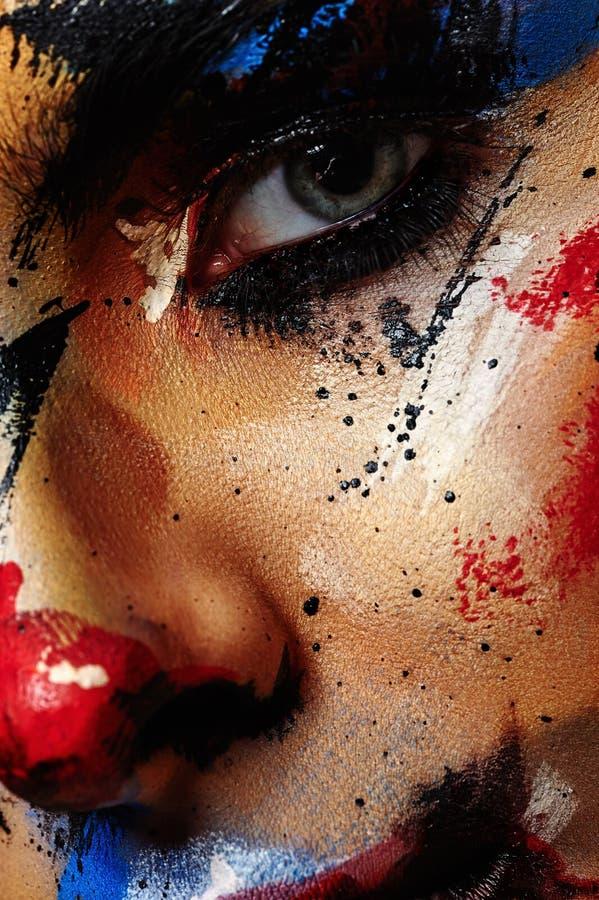 Composição artística do palhaço da beleza na cara do ` s da mulher foto de stock royalty free