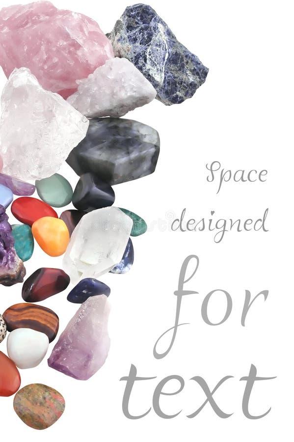 Composição colhida de vários cristais no fundo branco fotografia de stock royalty free