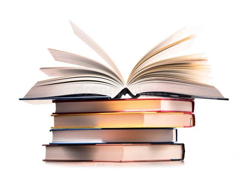 Composição com os livros isolados no branco imagem de stock