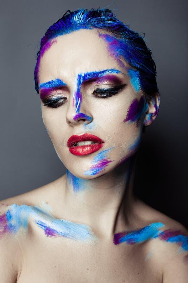 Composição criativa da arte de uma moça com olhos azuis imagens de stock royalty free