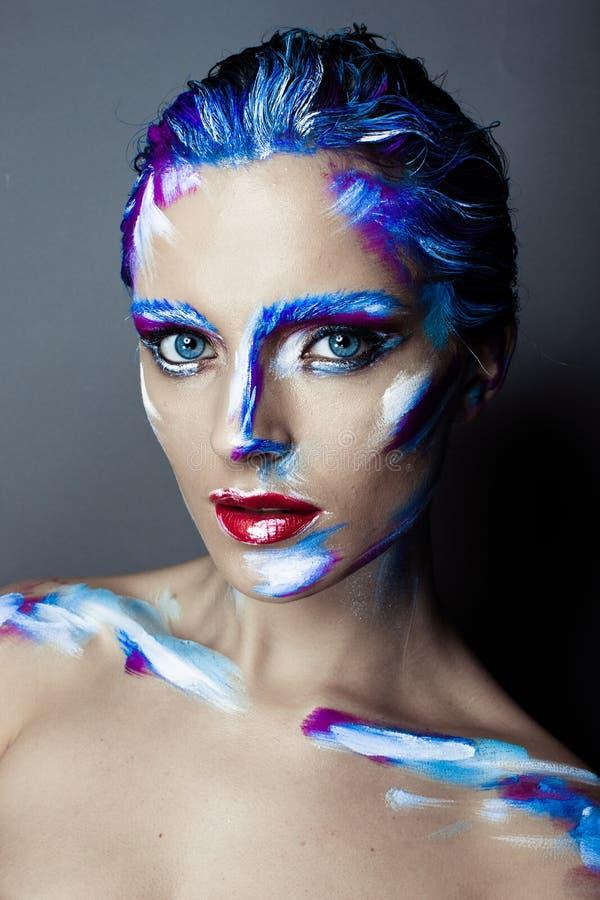 Composição criativa da arte de uma moça com olhos azuis fotos de stock royalty free