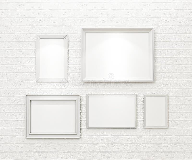 Composição das molduras para retrato vazias brancas na parede de tijolo branca com projetores ilustração do vetor