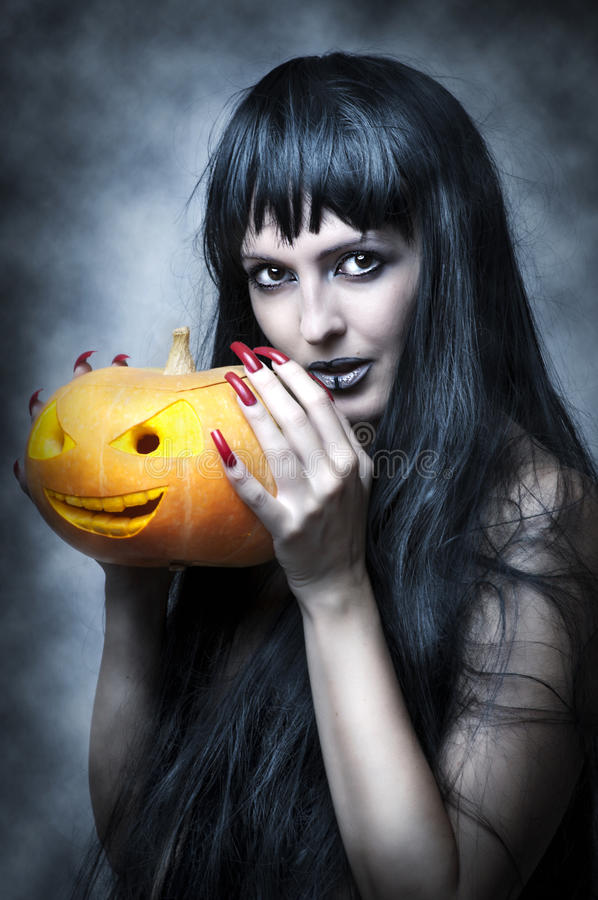 Composição de Halloween. Mulher 'sexy' imagem de stock royalty free