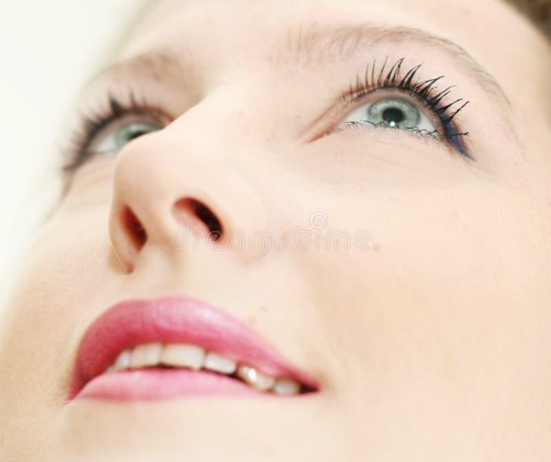 Composição na face de sorriso da mulher imagem de stock