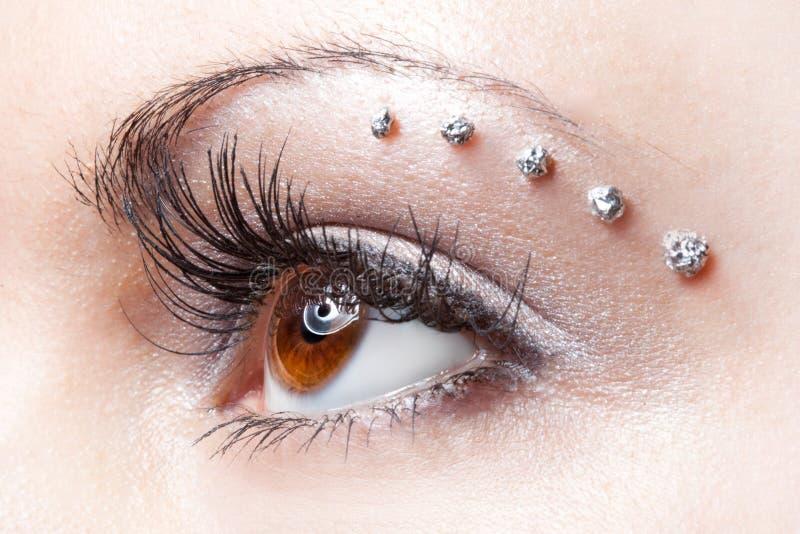 Composição no olho da mulher imagem de stock royalty free