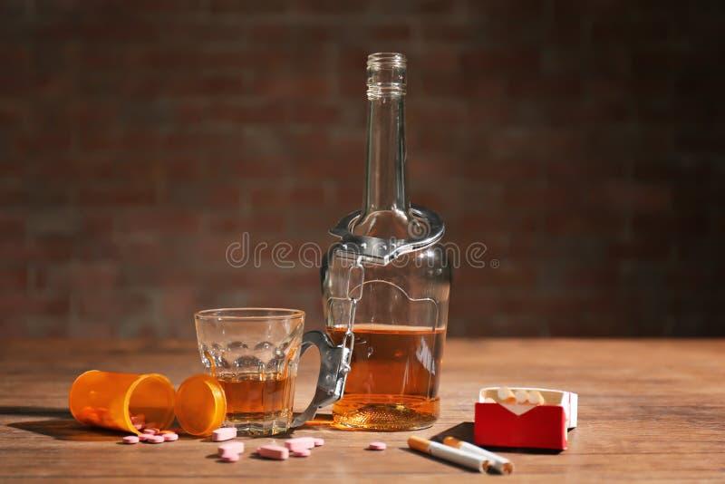 Composición con el alcohol, drogas imagen de archivo