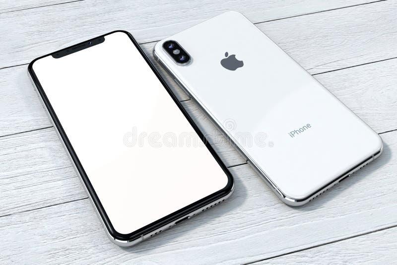 Composición de la maqueta de la plata de IPhone Xs en la madera blanca imagen de archivo libre de regalías