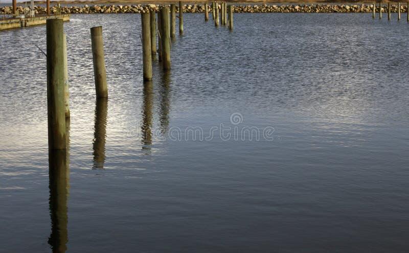 Composición de las columnas del embarcadero fotografía de archivo