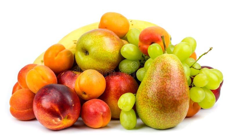 Composición de las diversas frutas exóticas aisladas en el backgroun blanco fotos de archivo