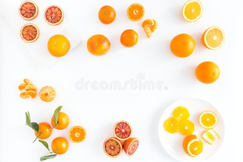 Composición de las naranjas de sangre, de las naranjas y de las clementinas imágenes de archivo libres de regalías