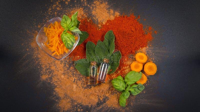 Composición del balneario del sabio, de la zanahoria y del aceite esencial foto de archivo libre de regalías