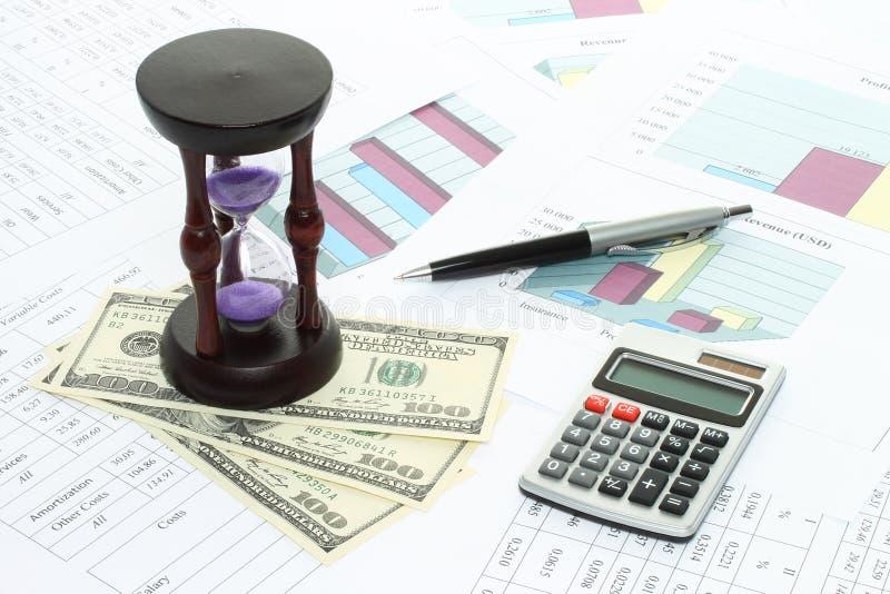 Composición del negocio de los gráficos, tablas, dinero, reloj de la arena fotografía de archivo