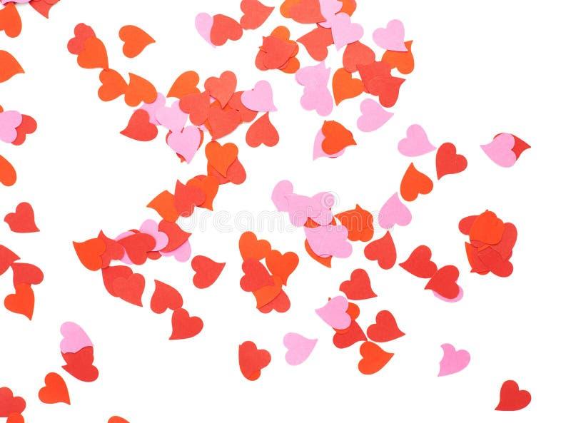 Composición en forma de corazón del confeti fotos de archivo