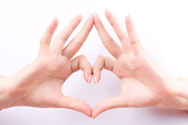 Composición que enmarca de la forma del corazón del amor del concepto de los símbolos de la mano del finger en el fondo blanco imágenes de archivo libres de regalías