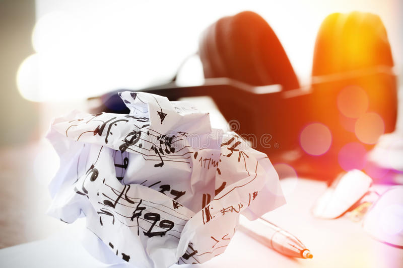 Composing music concept with shallow DOF evenly matched crumpled. Musical notes paper and exposure bokeh royalty free stock image