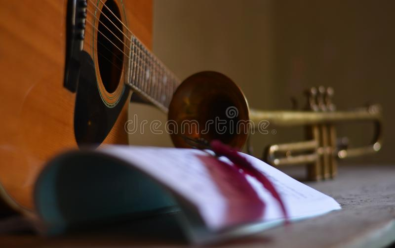 Composing new melodies, with trumpet and guitar. Music accompanies life as a soundtrack of the times royalty free stock image