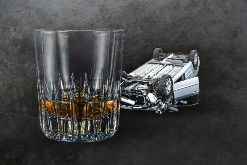 Composite of alcohol drink whiskey glass and crashed car wrecked on grunge background representing drunk and intoxicated. Driver suffering accident in royalty free stock photo