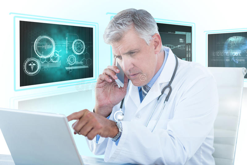 Composite 3d image of male doctor pointing at laptop while using mobile phone. Male doctor pointing at laptop while using mobile phone against white background stock image