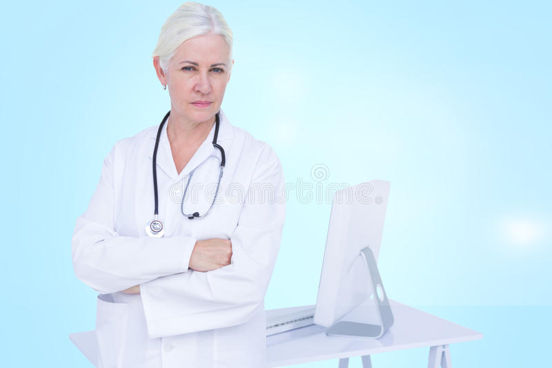 Composite 3d image of portrait of confident female doctor standing by desk royalty free stock photos