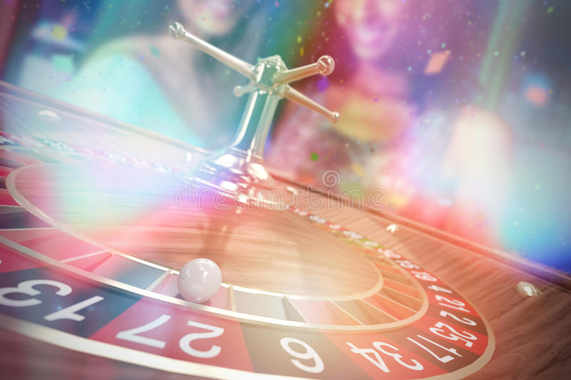 Composite 3d image of portrait of two women having cocktail. Portrait of two women having cocktail against 3d image of ball on wooden roulette wheel stock photos
