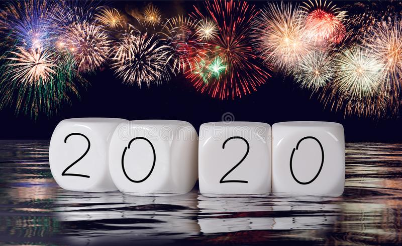 Composite of fireworks and calendar for 2020 New Year holiday background stock images