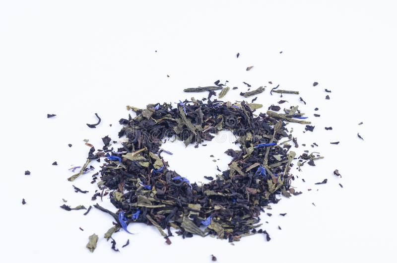 Composite heart-shaped tea with blue flowers.  royalty free stock photography